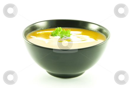 Tomato Soup in a Black Bowl stock photo, Rich red deliicious tomato soup in a small round black bowl with cream and a sprig of parsley on a white background by Keith Wilson