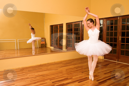Ballerina #15 stock photo, Ballerina dancing in a studio. by Sean Nel