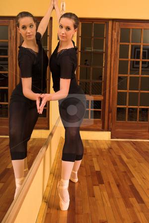 Ballerina #38 stock photo, Ballerina standing against mirror by Sean Nel