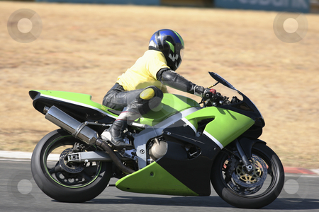 Superbike #52 stock photo, High speed Superbike on the circuit  by Sean Nel