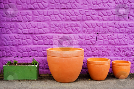 Pots #1 stock photo, Colourful pots on gravelroad next to purple wall by Sean Nel