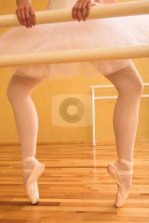 Ballet #11 stock photo, Ballerina standing at a ballet bar. by Sean Nel