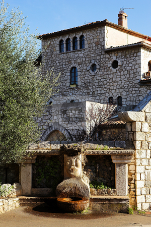 Village of St Paul stock photo, Fountains and buildings with windows and doors in the quaint little French hilltop village of Saint-Paul de Vence, Southern France,  Alpes Maritimes, next to the Mediterranean sea - A Heritage Site by Sean Nel