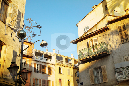 Buildings in Antibes stock photo, Building with shutters on windows in Antibes, France. by Sean Nel