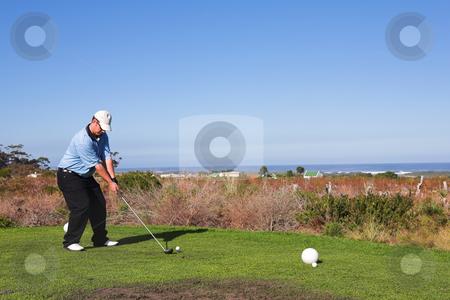 Golfer #57 stock photo, A golfer playing golf on a green. by Sean Nel