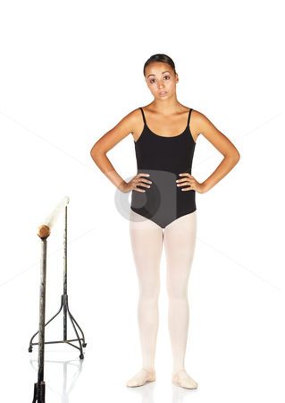 Ballet Steps stock photo, Tired young caucasian ballerina girl on white background and reflective white floor next to a barre. Not Isolated. by Sean Nel