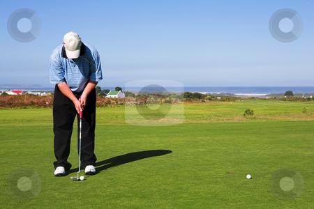 Golfer #55 stock photo, A golfer playing golf on a green. by Sean Nel