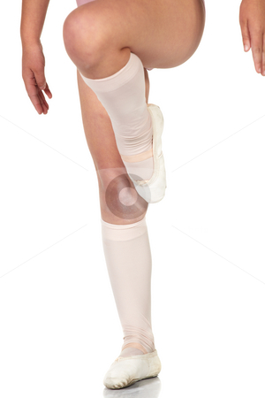 Ballet Feet Positions stock photo, Young female ballet dancer showing various classic ballet feet positions on a white background - beginner Skip position with Lifted Foot. NOT ISOLATED by Sean Nel