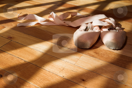 Pointe Shoes on studio floor stock photo, Pair of Ballet shoes lying on a wooden studio floor by Sean Nel