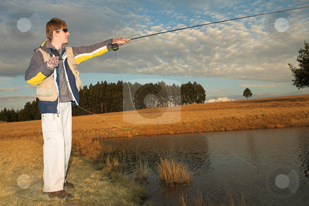 Flyfishing #24 stock photo, A fly fisherman casting a line in Dullstroom, South Africa by Sean Nel