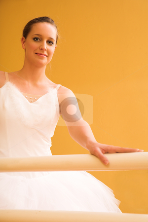 Bellerina #10 stock photo, Bellerina standing at a ballet bar. by Sean Nel
