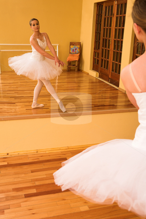 Ballerina #26 stock photo, Ballerina dancing in front of a mirror by Sean Nel