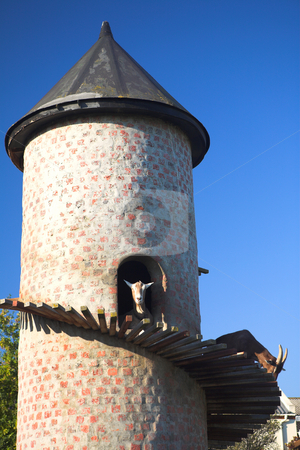 Billy goat in goat tower stock photo, Billy goat in a climbing tower against a blue sky  by Sean Nel