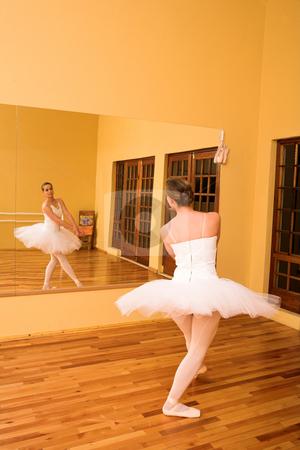 Ballerina #25 stock photo, Ballerina dancing in front of mirror by Sean Nel