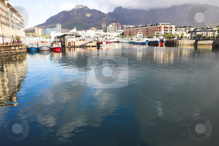 Cape Town Waterfront harbor stock photo, Cape Town waterfront harbor with three boats reflecting in the water and the City skyline in the background. by Sean Nel