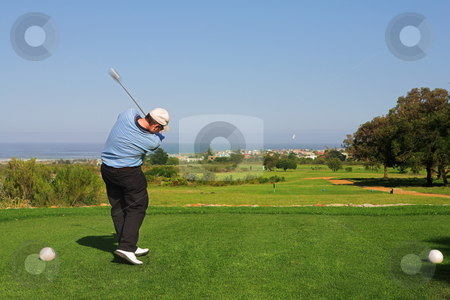 Golfer #66 stock photo, A golfer playing golf on a green.  Movement on the golf club, and the ball. by Sean Nel