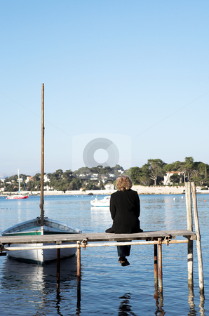 Antibes #255 stock photo, A person sitting on a pier in Antibes, France.   copy space. by Sean Nel
