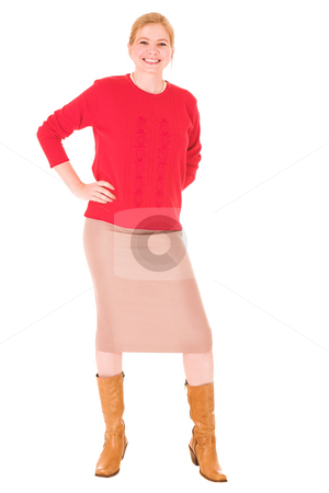 Middle aged businesswoman stock photo, Blonde middle aged businesswoman with a red jersey and beige dress on a white background by Sean Nel
