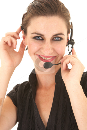 Sexy brunette businesswoman stock photo, Sexy young adult Caucasian businesswoman in a tight black sexy blouse on a white background with a telephone headset by Sean Nel