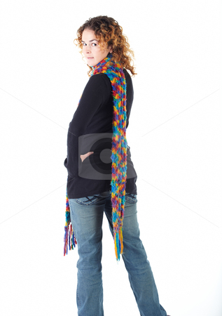 Young adult woman stock photo, Cute young adult caucasian woman curly red hair in a black top, blue jeans and a colorful scarf on a white background in various poses, with various facial expressions. Not Isolated by Sean Nel