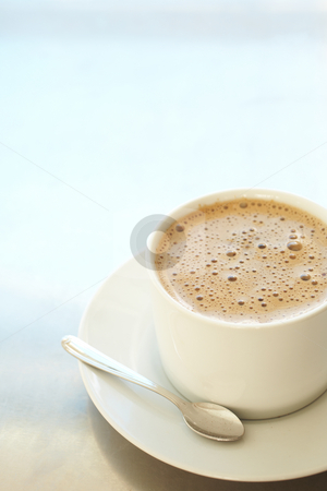 Cafe latte in coffee cup stock photo, Fresh foamy cafe latte in white coffee cup on a silver background with lots of copy space ? Shallow Depth of Field, focus on Foam by Sean Nel