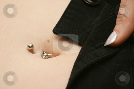 Pierced navel stock photo, Star stud piercing through navel by Sean Nel