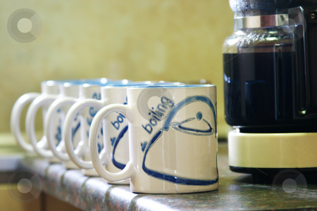 Coffee Mugs stock photo, Coffe mugs lined up next to coffee pot by Sean Nel