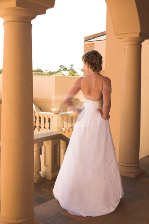 Beautiful young bride stock photo, Slim beautiful adult woman with short blonde, curly hair wearing luxurious silk wedding dress on location by Sean Nel