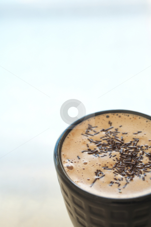 Cafe latte in coffee mug stock photo, Fresh foamy cafe latte in black coffee mug with chocolate sprinkles on a silver background with lots of copy space ? Shallow Depth of Field, focus on chocolate sprinkles by Sean Nel