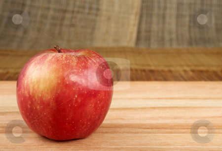 Apple #2 stock photo, Red apple on wooden cutting board - copy space by Sean Nel