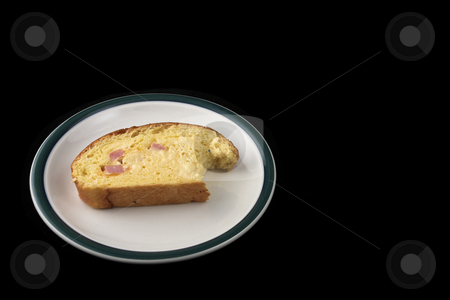 Bread #11 stock photo, Slice of bread on plate on black background by Sean Nel