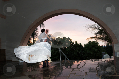 Joy stock photo, Groom swinging his bride by Sean Nel