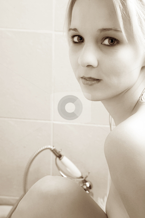 Woman #142 stock photo, Nude woman in a bath.  Copy space.  Sepia tone. by Sean Nel