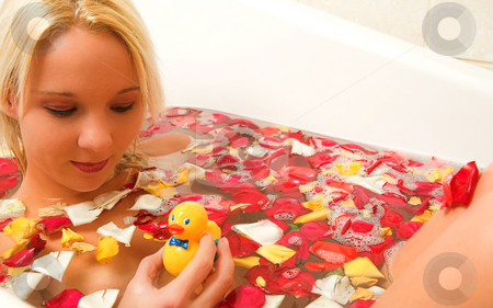 Woman #181 stock photo, Nude woman in a bath, holding a plastic toy duck. by Sean Nel