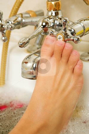 Woman #178 stock photo, Foot of a woman in a bath. by Sean Nel