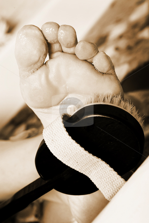 Woman #151 stock photo, Foot being washed in a bath. by Sean Nel