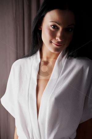 Young adult woman stock photo, Robed young adult caucasian woman with black her standing against a curtain in her bedroom (blue eyes through coloured contact lenses) by Sean Nel