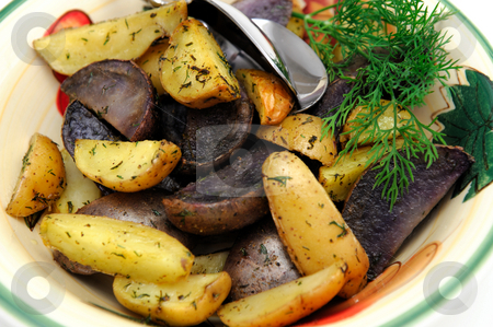 Roasted Potatoes With Dill stock photo, Purple and yellow new potatoes roasted in olive oil and spices including Dill weed by Lynn Bendickson