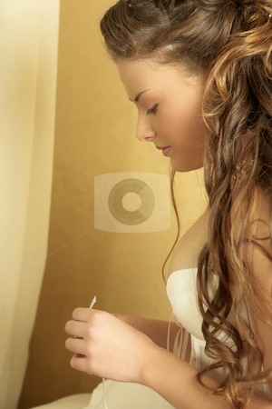 Lingerie#258 stock photo, Woman in underwear sitting on a bed.  Looking down. by Sean Nel