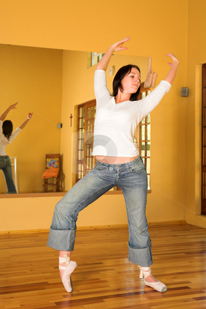 Modern Dancer #9 stock photo, Modern Ballet Dancer in blue jeans and Pointe Shoes. Practicing in Studio by Sean Nel