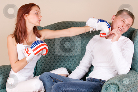 Couple #43 stock photo, Woman hitting her boyfriend with boxing gloves by Sean Nel