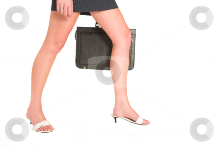 Laura Hopton #18 stock photo, Business woman walking, holding a leather suitcase - copy space by Sean Nel