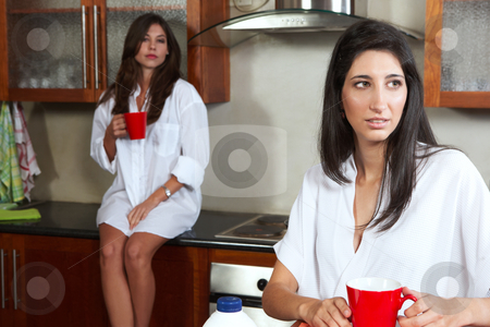 Sexy brunette roommates stock photo, Sexy young adult brunette roommates in lingerie drinking morning coffee in their kitchen before work by Sean Nel