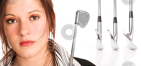 Businesswoman with brown hair and golf equipment stock photo, Businesswoman with brown hair, dressed in a white shirt with black stripes. Holding a golf club over her shoulder. Background has a row of professional golf clubs isolated on white. by Sean Nel