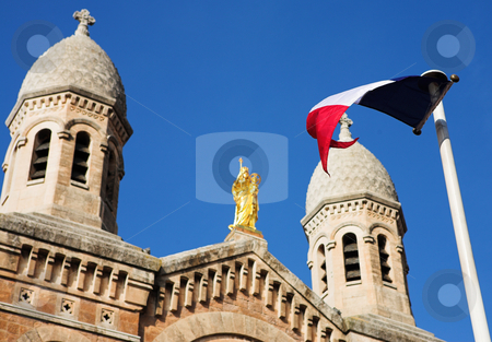 StRaphael #17 stock photo, The Victoire de Lepante Cathedral in Victory Square, St Raphael, France - Shallow DOF, focus on Flag by Sean Nel