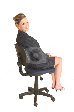 Business Woman #26 stock photo, Business woman on office chair, looking over her shoulder smiling by Sean Nel