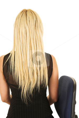 Blonde businesswoman in black on office chair stock photo, Businesswoman in black sitting on a blue and black office chair with her long blonde hair and her back to the viewer - isolated on white by Sean Nel