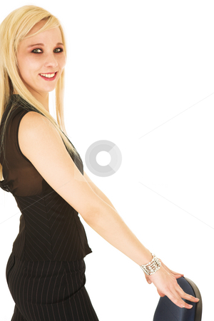 Blonde businesswoman in black on office chair stock photo, Smiling blonde businesswoman in black trousers on blue and black office chair - isolated on white by Sean Nel