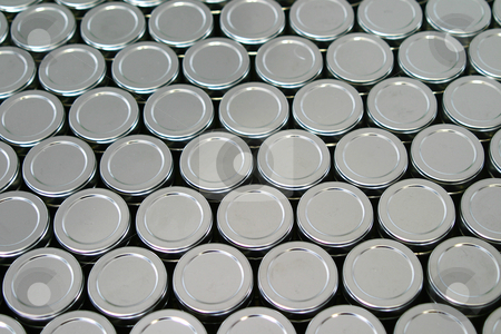 Tins stock photo, Metal lids of packaging tins by Sean Nel
