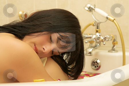 Woman #113 stock photo, Nude woman in a bath. by Sean Nel